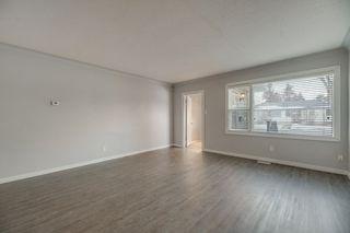 Photo 7: 10701 - 10703 135 Street in Edmonton: Zone 07 House Duplex for sale : MLS®# E4190600