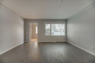 Photo 6: 10701 - 10703 135 Street in Edmonton: Zone 07 House Duplex for sale : MLS®# E4190600