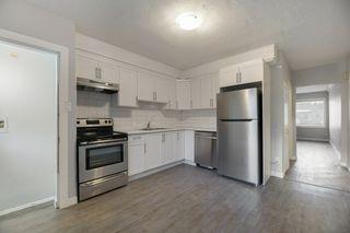 Photo 10: 10701 - 10703 135 Street in Edmonton: Zone 07 House Duplex for sale : MLS®# E4190600