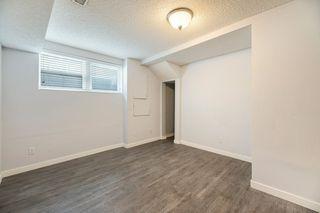 Photo 32: 10701 - 10703 135 Street in Edmonton: Zone 07 House Duplex for sale : MLS®# E4190600
