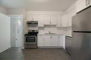 Photo 9: 10701 - 10703 135 Street in Edmonton: Zone 07 House Duplex for sale : MLS®# E4190600