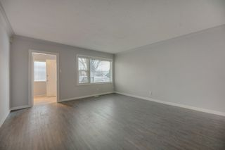 Photo 5: 10701 - 10703 135 Street in Edmonton: Zone 07 House Duplex for sale : MLS®# E4190600