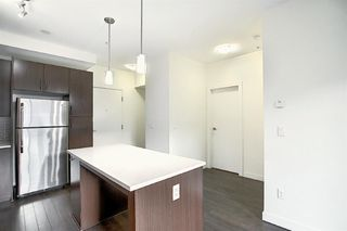 Photo 4: 117 15233 1 Street SE in Calgary: Midnapore Apartment for sale : MLS®# A1040196
