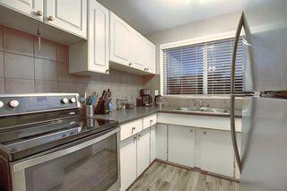 Photo 5: 90 5425 Pensacola Crescent SE in Calgary: Penbrooke Meadows Row/Townhouse for sale : MLS®# A1040260