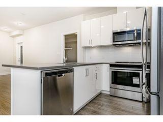 "Photo 8: 113 15351 101 Avenue in Surrey: Guildford Condo for sale in ""The Guildford"" (North Surrey)  : MLS®# R2464416"
