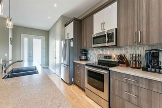 Photo 6: 627 Country Meadows Close NW: Turner Valley Detached for sale : MLS®# A1020058