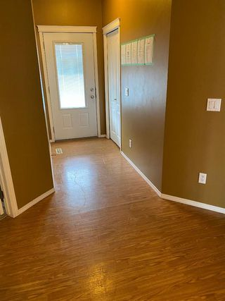 Photo 2: 415 Sunrise Terrace NE: High River Row/Townhouse for sale : MLS®# A1037951