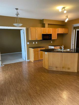 Photo 4: 415 Sunrise Terrace NE: High River Row/Townhouse for sale : MLS®# A1037951