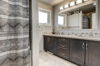 Photo 21: 5631 LODGE Crescent SW in Calgary: Lakeview Detached for sale : MLS®# C4261500