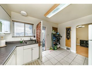 Photo 10: 1414 E 60TH Avenue in Vancouver: Fraserview VE House for sale (Vancouver East)  : MLS®# R2396473