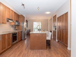 """Photo 5: 101 2738 158 Street in Surrey: Grandview Surrey Townhouse for sale in """"Cathedral Grove"""" (South Surrey White Rock)  : MLS®# R2414064"""