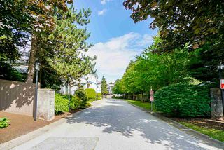 "Main Photo: 203 9118 149 Street in Surrey: Bear Creek Green Timbers Townhouse for sale in ""Wildwood Glen"" : MLS®# R2469643"