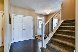 Photo 5: 240 Auburn Springs Close SE in Calgary: Auburn Bay Detached for sale : MLS®# C4297821