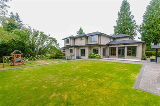 Photo 1: 7451 LAMBETH Drive in Burnaby: Buckingham Heights House for sale (Burnaby South)  : MLS®# R2389583