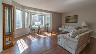 Photo 4: 21 RICHELIEU Court SW in Calgary: Lincoln Park Row/Townhouse for sale : MLS®# A1013241
