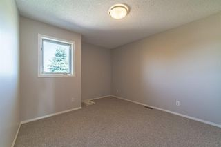 Photo 17: 21 RICHELIEU Court SW in Calgary: Lincoln Park Row/Townhouse for sale : MLS®# A1013241