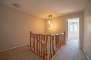 Photo 13: 21 RICHELIEU Court SW in Calgary: Lincoln Park Row/Townhouse for sale : MLS®# A1013241