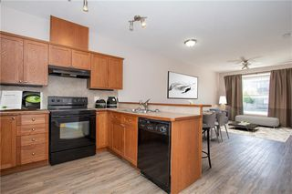 Photo 4: 802 2005 LUXSTONE Boulevard SW: Airdrie Row/Townhouse for sale : MLS®# C4287850