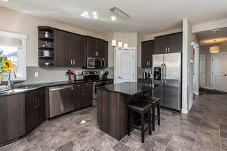 Photo 4: 1189 HAYS Drive in Edmonton: Zone 58 House for sale : MLS®# E4213069