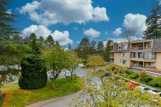 "Photo 1: 201 1740 SOUTHMERE Crescent in Surrey: Sunnyside Park Surrey Condo for sale in ""Capstan Way: Spinnaker II"" (South Surrey White Rock)  : MLS®# R2526550"