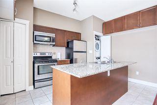 "Photo 11: 102 12088 75A Avenue in Surrey: West Newton Condo for sale in ""The Villas at Strawberry Hill"" : MLS®# R2428935"