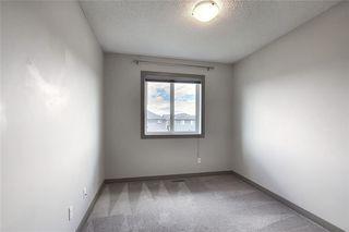 Photo 28: 90 FIRESIDE Cove: Cochrane Semi Detached for sale : MLS®# C4300297