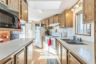 Photo 11: 105 Heritage Drive: Okotoks Mobile for sale : MLS®# A1047179