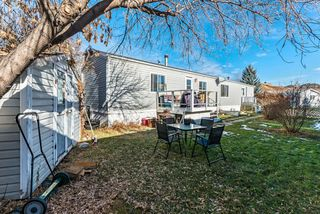 Photo 2: 105 Heritage Drive: Okotoks Mobile for sale : MLS®# A1047179