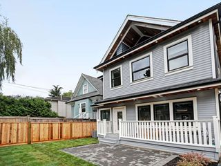 Photo 1: 1760 E 14TH AVENUE in Vancouver: Grandview Woodland House 1/2 Duplex for sale (Vancouver East)  : MLS®# R2403683