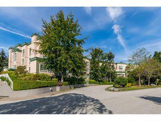 "Photo 1: 430 13880 70 Avenue in Surrey: East Newton Condo for sale in ""CHELSEA GARDENS"" : MLS®# R2488971"