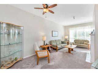 "Photo 7: 430 13880 70 Avenue in Surrey: East Newton Condo for sale in ""CHELSEA GARDENS"" : MLS®# R2488971"