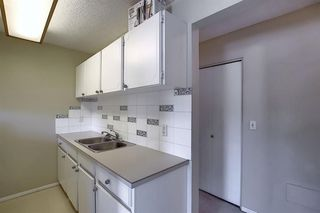 Photo 5: 6 714 5A Street NW in Calgary: Sunnyside Apartment for sale : MLS®# A1031128