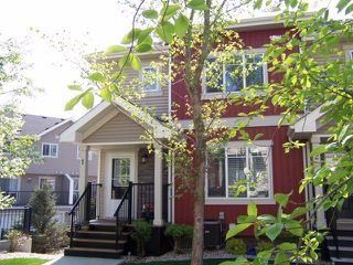 Photo 2: 1 675 ALBANY Way in Edmonton: Zone 27 Townhouse for sale : MLS®# E4179424