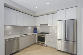 "Photo 1: 403 3588 SAWMILL Crescent in Vancouver: South Marine Condo for sale in ""Avalon 1"" (Vancouver East)  : MLS®# R2447025"