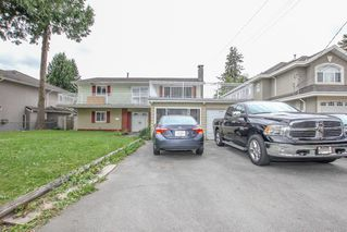 Photo 1: 12341 95A Avenue in Surrey: Queen Mary Park Surrey House for sale : MLS®# R2457932
