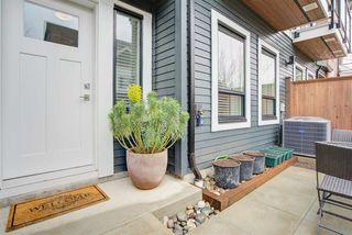 """Photo 1: 11 303 171 Street in Surrey: Pacific Douglas Townhouse for sale in """"FAIRWAYS"""" (South Surrey White Rock)  : MLS®# R2492203"""