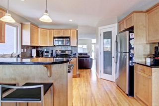 Photo 10: 6023 LEWIS Drive SW in Calgary: Lakeview Detached for sale : MLS®# A1028692