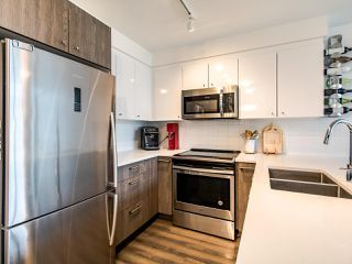 """Photo 6: 507 2525 CLARKE Street in Port Moody: Port Moody Centre Condo for sale in """"THE STRAND"""" : MLS®# R2493487"""