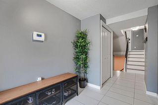 Photo 3: 52 1011 Canterbury Drive SW in Calgary: Canyon Meadows Row/Townhouse for sale : MLS®# A1059237