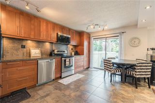 Photo 5: 24 10001 BROOKPARK Boulevard SW in Calgary: Braeside Row/Townhouse for sale : MLS®# C4297216