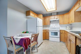Photo 6: 401 305 1 Avenue NW: Airdrie Apartment for sale : MLS®# A1040343