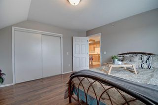 Photo 12: 401 305 1 Avenue NW: Airdrie Apartment for sale : MLS®# A1040343
