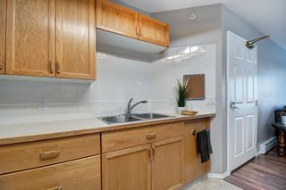 Photo 9: 401 305 1 Avenue NW: Airdrie Apartment for sale : MLS®# A1040343