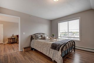 Photo 11: 401 305 1 Avenue NW: Airdrie Apartment for sale : MLS®# A1040343