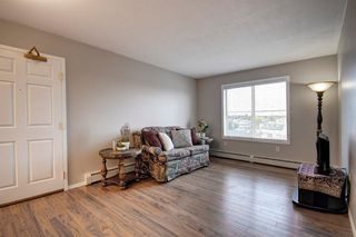 Photo 4: 401 305 1 Avenue NW: Airdrie Apartment for sale : MLS®# A1040343
