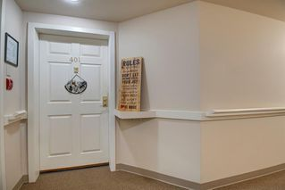 Photo 3: 401 305 1 Avenue NW: Airdrie Apartment for sale : MLS®# A1040343