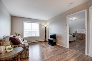 Photo 5: 401 305 1 Avenue NW: Airdrie Apartment for sale : MLS®# A1040343