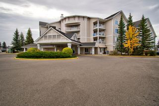 Photo 2: 401 305 1 Avenue NW: Airdrie Apartment for sale : MLS®# A1040343
