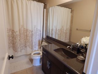 Photo 34: 215 Panatella View in Calgary: Panorama Hills Detached for sale : MLS®# A1046159