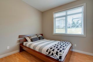 Photo 11: 6 116 Rockyledge View NW in Calgary: Rocky Ridge Row/Townhouse for sale : MLS®# A1040430